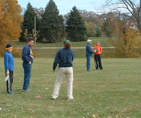 Tracey Lopez helping teach new players fundamentals at a local disc golf clinic at Middle Park 2006